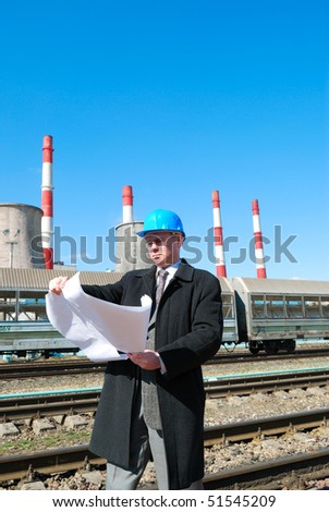Engineer with blue hard hat holding drawing - stock photo