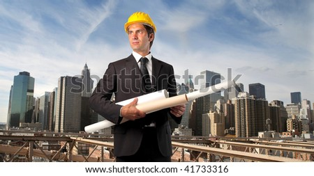 engineer with blue print rolls - stock photo