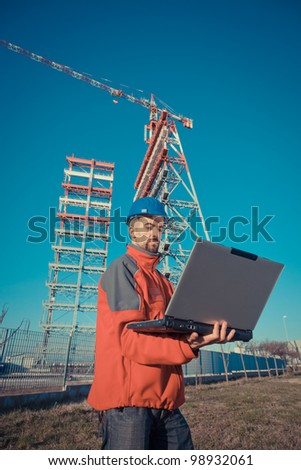 Engineer with Computer in Construction Site