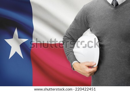 Engineer with flag on background series - Texas - stock photo