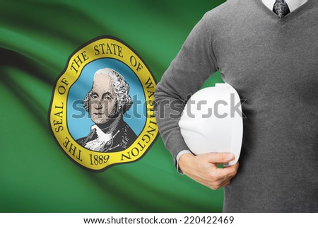 Engineer with flag on background series - Washington - stock photo