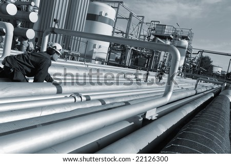 engineer with giant pipeline construction, blue toning idea - stock photo