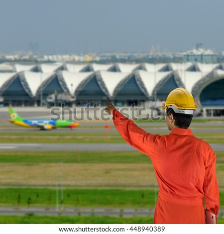 engineer with helmet for workers security on background of architecture detail of Bangkok Airport in Thailand - stock photo