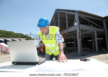 Engineer with security helmet on construction site - stock photo