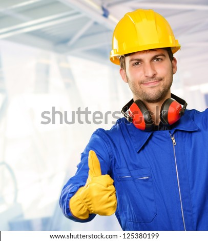 Engineer With Thumb Up Sign, Indoors - stock photo