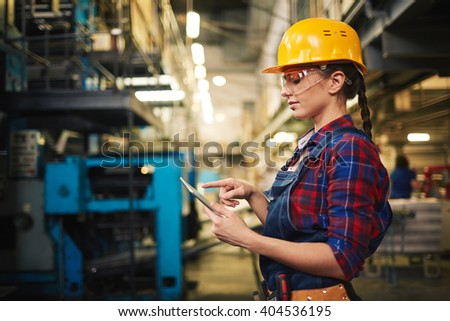 Engineer with touchpad - stock photo