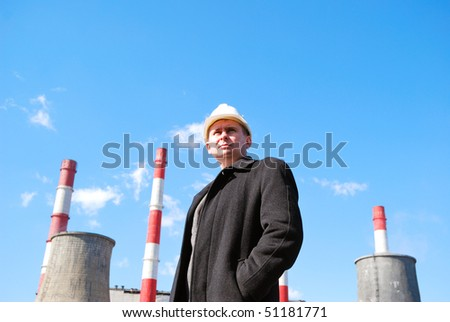 Engineer with white hard hat on industrial area background - stock photo