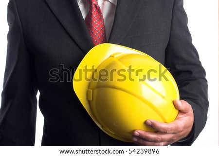 Engineer with yellow hard hat - stock photo