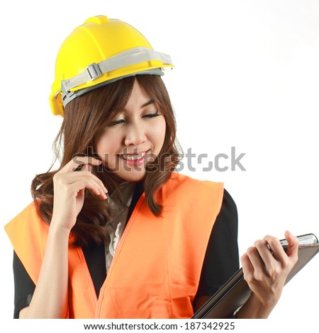 Engineer woman using digital tablet computer PC smiling happy isolated on white background.  - stock photo