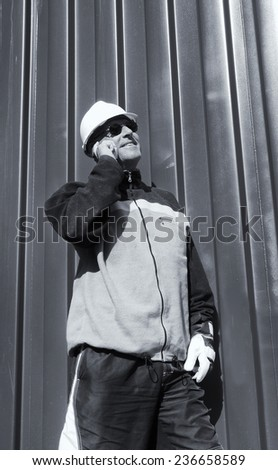 engineer, worker in hard-hat set against steel background - stock photo