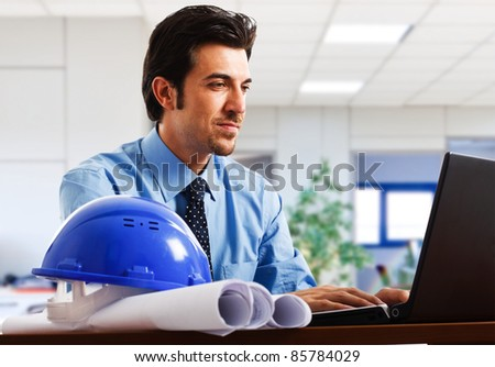 Engineer working at his laptop in the office