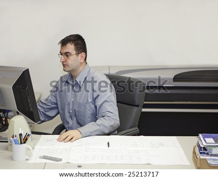 engineer working on a computer in a office - stock photo