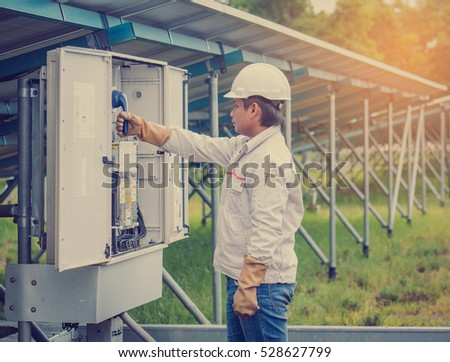 engineer working on checking and maintenance equipment at green energy solar power plant engineer checking - Power Plant Engineer
