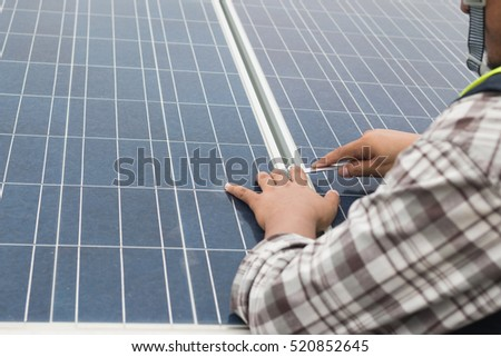 engineer working on checking and maintenance equipment at green energy solar power plant: Wrench tightening at solar mounting structure