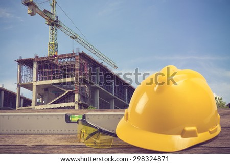 engineer working table plan at building construction site vintage color - stock photo