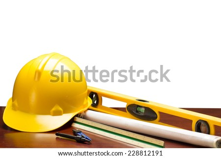 engineer working table plan building model and writing tool equipment and blueprints  isolated on white background with clipping path - stock photo