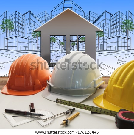 engineer working table with construction industry and engineering working tool on top of table use for real estate and property land development theme  - stock photo