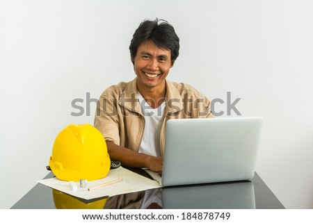 engineer working with laptop on the desk