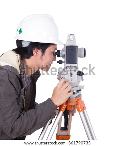 engineer working with survey equipment theodolite on a tripod. Isolated on white background - stock photo