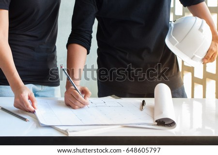 Engineer write on blueprint by pencilmeeting stock photo 648605797 engineer write on blueprint by pencilmeeting to discuss project concept and draw in document malvernweather Gallery