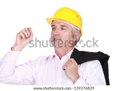 Engineer writing on a board - stock photo