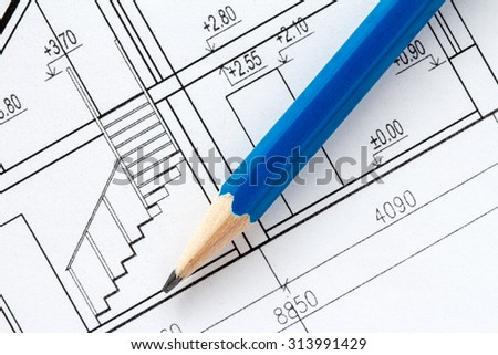 Engineering and architecture drawings with blue pencil - stock photo