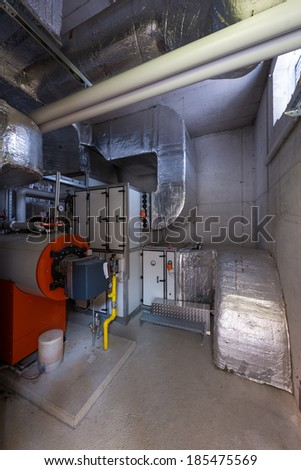 engineering and plant room with thermally insulated pipes - stock photo