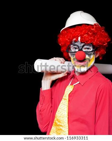 Engineering Clown Holding Rolled Up Blueprint In A Depiction Of Unstable And Dodgy Building Practices - stock photo