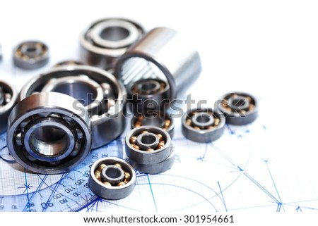 Engineering concept. Few ball bearings near protractor on blueprint background - stock photo