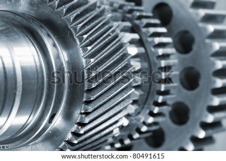 engineering concept of gear wheels, titanium and steel - stock photo