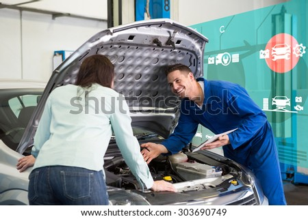 Engineering interface against mechanic showing customer the problem with car - stock photo