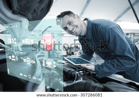 Engineering interface against mechanic using tablet on car - stock photo
