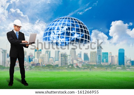 Engineering looking on laptop for work plant : Elements of this image furnished by NASA - stock photo