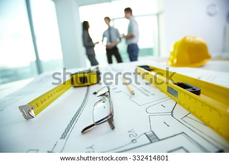 Engineering objects on background of group of colleagues
