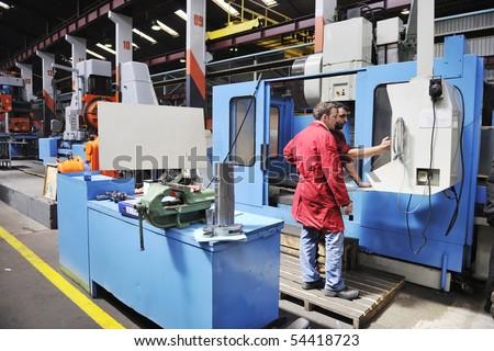 engineering people manofacturing industry with big modern computer mashines - stock photo