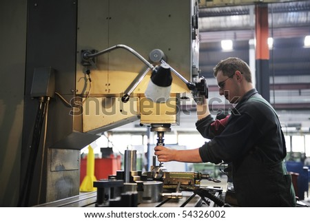 engineering people manufacturing industry with big modern computer machines - stock photo
