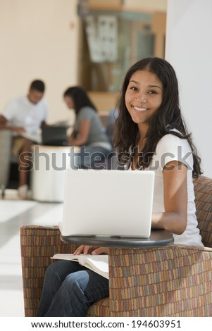 Engineering students studying in college academic center - stock photo