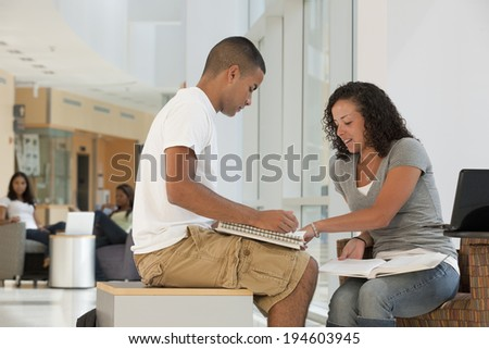 Engineering students studying together in pairs in a college academic center - stock photo