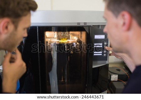 Engineering students using 3d printer at the university - stock photo