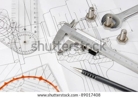 engineering tools on technical drawing - stock photo