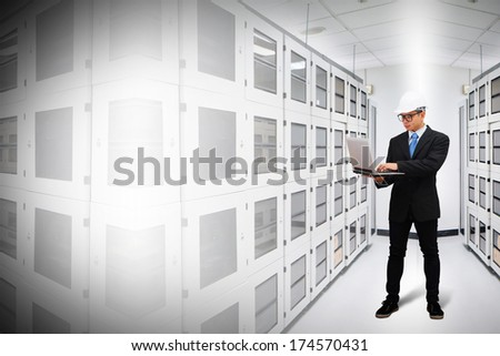 Engineering working on laptop - stock photo