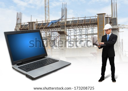 Engineering working with digital laptop  - stock photo