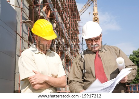 engineers at the construction site - stock photo