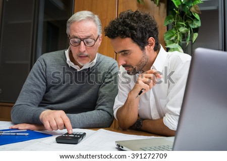 Engineers at work in their office - stock photo