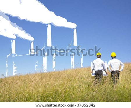 Engineers creating a factory - stock photo