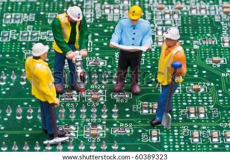 Engineers Fixing Computer Circuit Board - stock photo