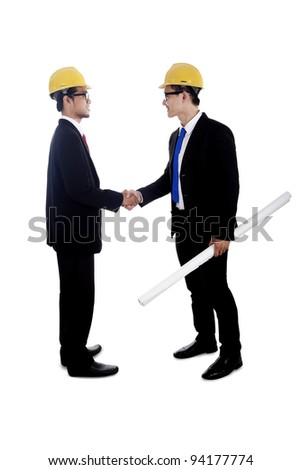 Engineers hand shake shot in studio isolated on white