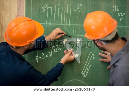 Engineers planning project on board - stock photo