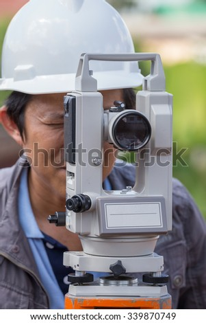 Engineers use tacheometer or theodolite for survey line columns for the construction of buildings - stock photo