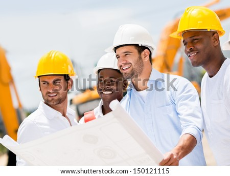 Engineers working on a building site holding a blueprints - stock photo